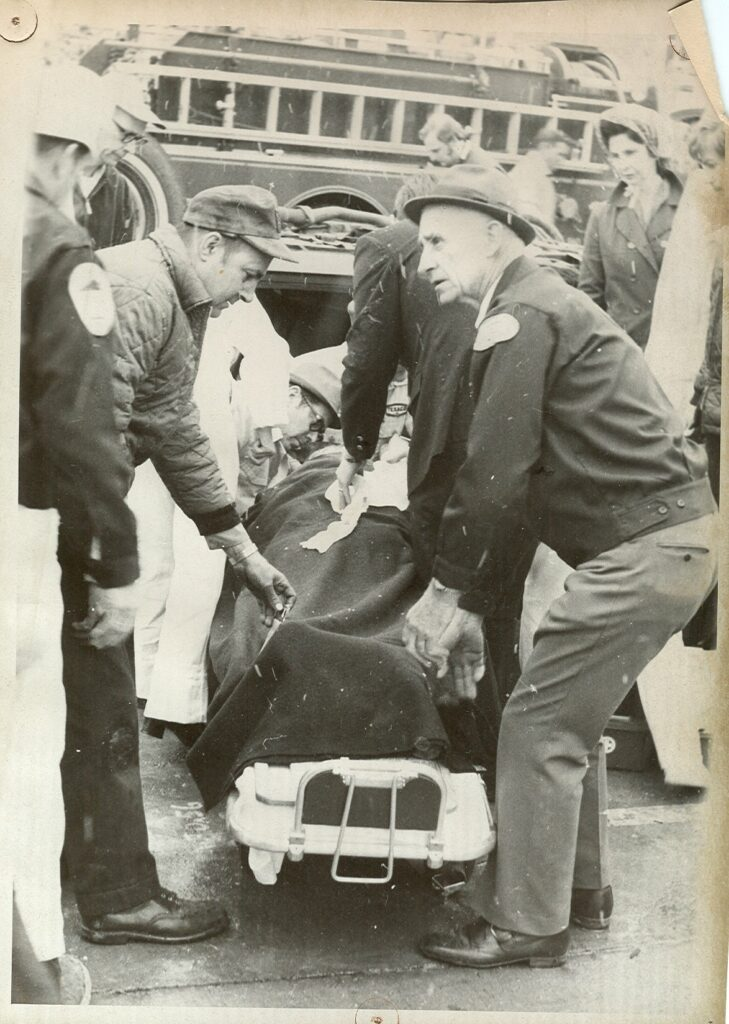 GVFRS black and white photo loading patient on stretcher